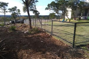 Iron fence installation project and landscaping