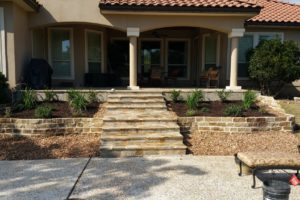 stone retaining wall, custom steps and landscape project