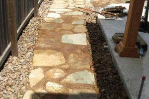 custom stone pathway with decorative rock