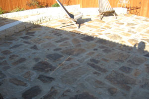 custom rock patio and fence installation in Boerne TX