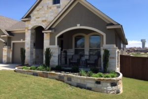 stone retaining wall and flower bed project