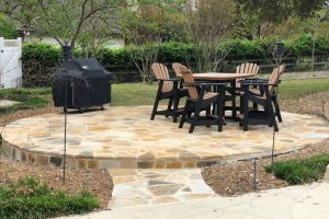 custom rounded stone patio with pathway