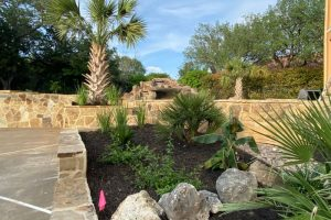 Stone patio and landscaping plant bed