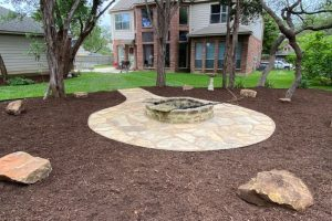 Stone patio, fire pit project and landscaping