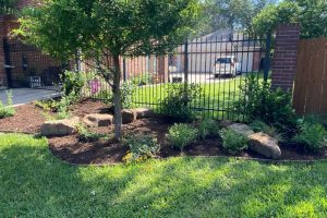 landscaping with bark, flowers, bushes and shrubs